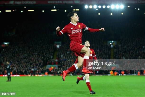 Philippe Coutinho of Liverpool scores his sides first goal during the Premier League match between Liverpool and Swansea City at Anfield on December...