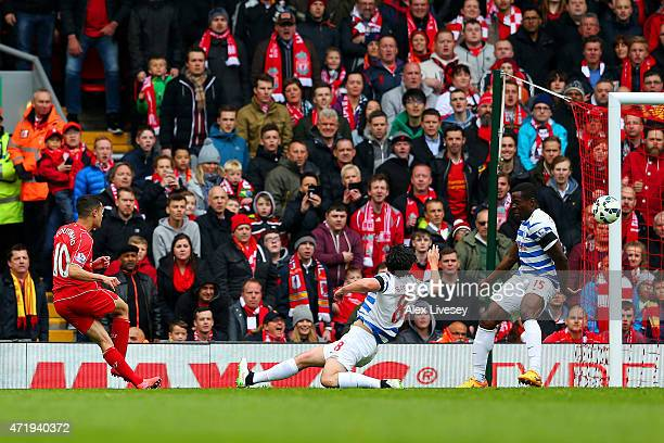 Philippe Coutinho of Liverpool scores his team's first goal during the Barclays Premier League match between Liverpool and Queens Park Rangers at...