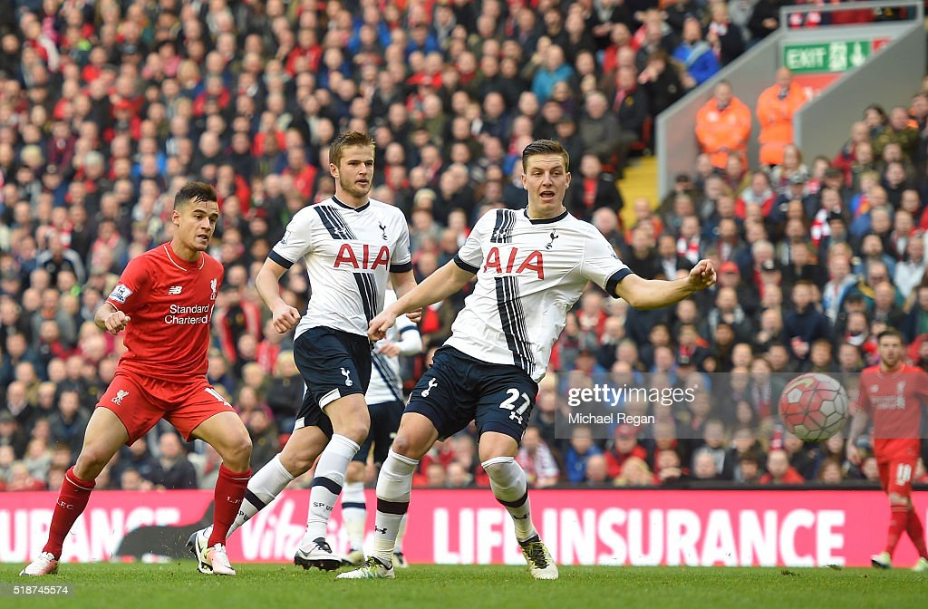 Philippe Coutinho of Liverpool scores his team's first goal during the Barclays Premier League match between Liverpool and Tottenham Hotspur at Anfield on April 2, 2016 in Liverpool, England.