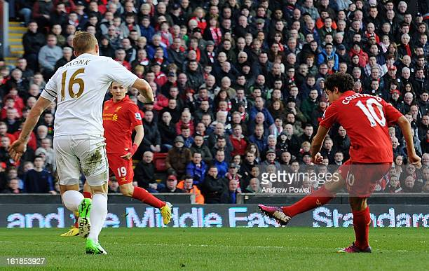 Philippe Coutinho of Liverpool scores his team's second goal during the Barclays Premier League match between Liverpool and Swansea City at Anfield...