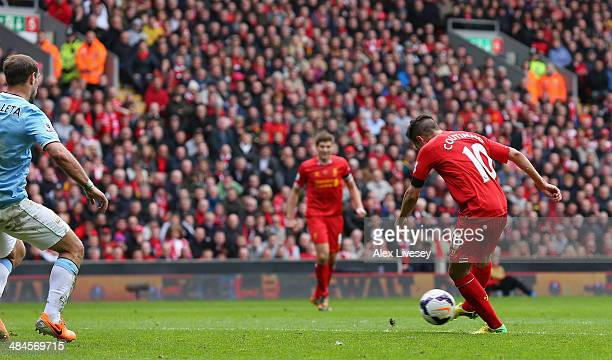 Philippe Coutinho of Liverpool scores his team's third goal during the Barclays Premier League match between Liverpool and Manchester City at Anfield...
