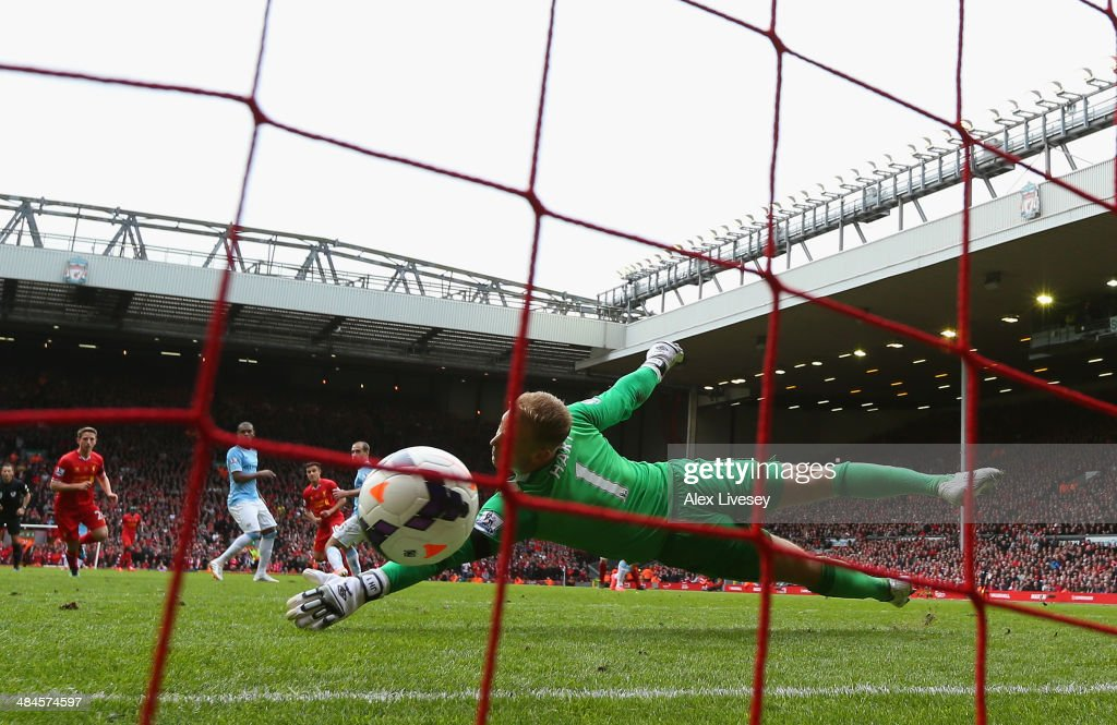 Philippe Coutinho of Liverpool scores his team's third goal during the Barclays Premier League match between Liverpool and Manchester City at Anfield on April 13, 2014 in Liverpool, England.