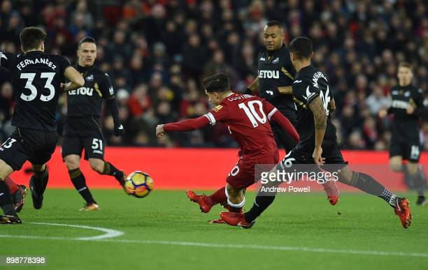 Philippe Coutinho of Liverpool Scores the opener during the Premier League match between Liverpool and Swansea City at Anfield on December 26 2017 in...