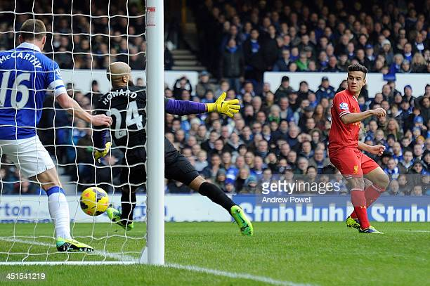 Philippe Coutinho of Liverpool scores the opening goal during the Barclays Premier League match between Everton and Liverpool at Goodison Park on...