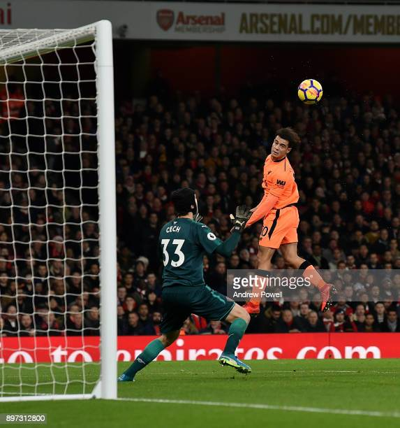 Philippe Coutinho of Liverpool scores the opening goal during the Premier League match between Arsenal and Liverpool at Emirates Stadium on December...
