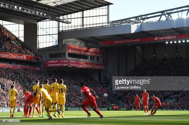 Philippe Coutinho of Liverpool scores the opening goal from a free kick during the Premier League match between Liverpool and Crystal Palace at...