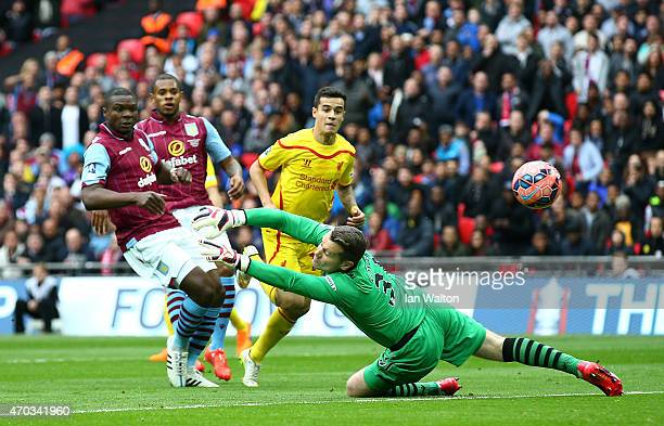Philippe Coutinho of Liverpool scores the opening goal past Shay Given of Aston Villa during the FA Cup Semi Final between Aston Villa and Liverpool...