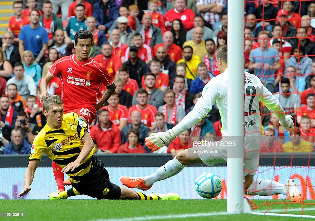 Philippe Coutinho of Liverpool scores the third goal during Pre Season Friendly match between Liverpool and Borussia Dortmund at Anfield on August 10, 2014 in Liverpool, England.