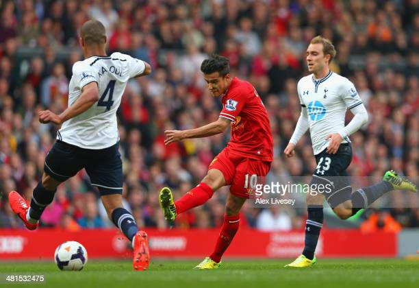 Philippe Coutinho of Liverpool scores the third goal during the Barclays Premier League match between Liverpool and Tottenham Hotspur at Anfield on...