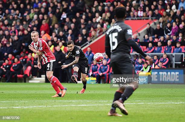 Philippe Coutinho of Liverpool scores their first goal during the Barclays Premier League match between Southampton and Liverpool at St Mary's...