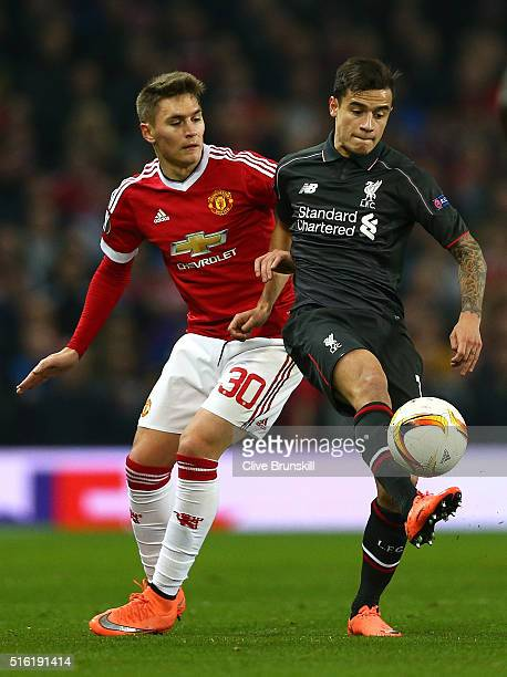Philippe Coutinho of Liverpool shields the ball from Guillermo Varela of Manchester United during the UEFA Europa League round of 16, second leg...