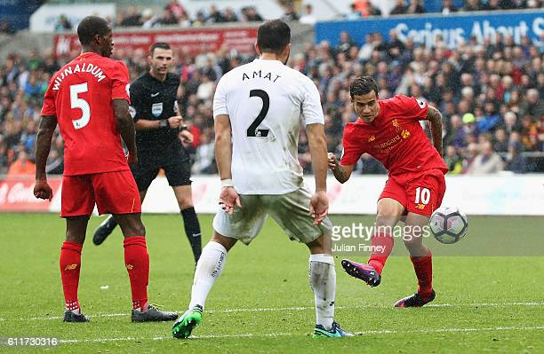 Philippe Coutinho of Liverpool shoots during the Premier League match between Swansea City and Liverpool at Liberty Stadium on October 1 2016 in...