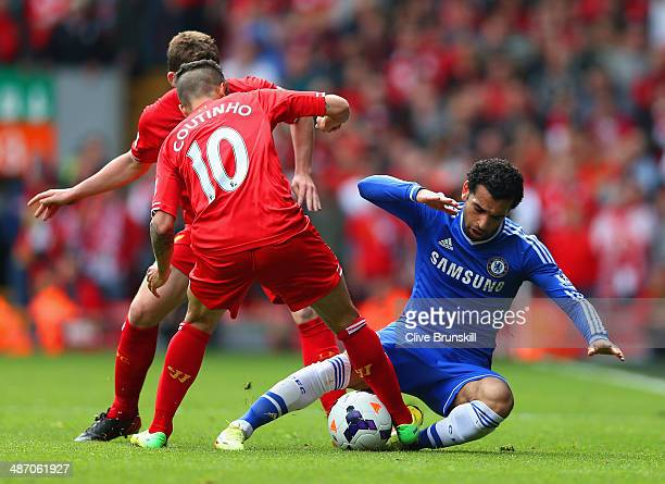 Philippe Coutinho of Liverpool tackles Mohamed Salah of Chelsea during the Barclays Premier League match between Liverpool and Chelsea at Anfield on...
