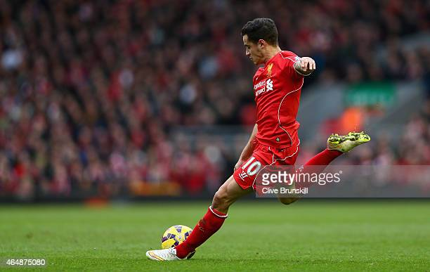 Philippe Coutinho of Liverpool takes a shot at goal during the Barclays Premier League match between Liverpool and Manchester City at Anfield on...