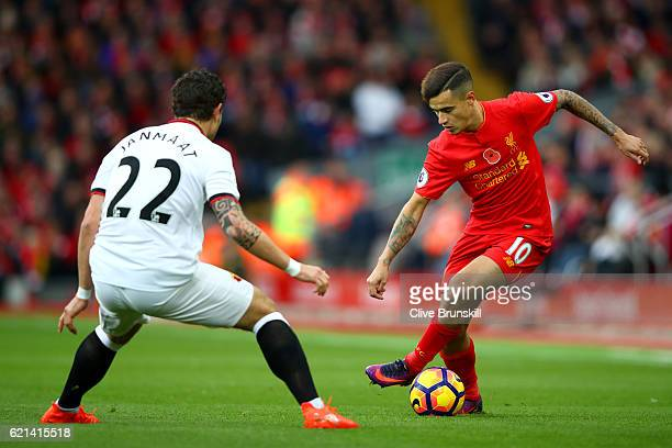 Philippe Coutinho of Liverpool takes on Daryl Janmaat of Watford during the Premier League match between Liverpool and Watford at Anfield on November...