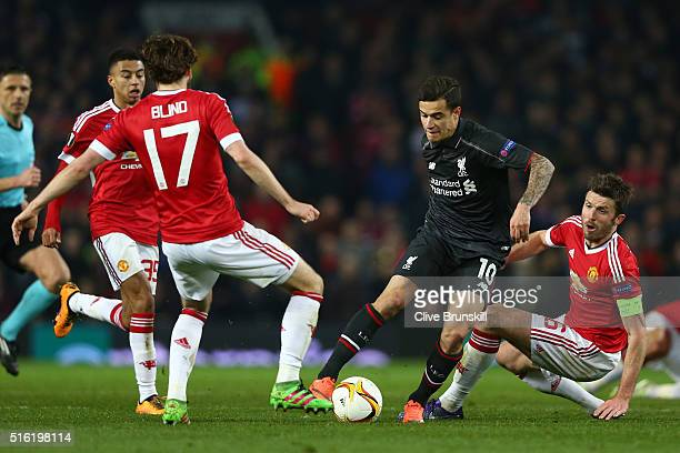 Philippe Coutinho of Liverpool takes on Jesse Lingard Daley Blind and Michael Carrick of Manchester United during the UEFA Europa League round of 16...