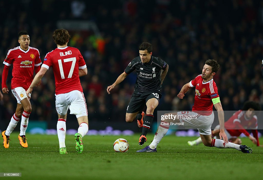 Philippe Coutinho of Liverpool takes on Jesse Lingard, Daley Blind and Michael Carrick of Manchester United during the UEFA Europa League round of 16 second leg match between Manchester United and Liverpool at Old Trafford on March 17, 2016 in Manchester, England.