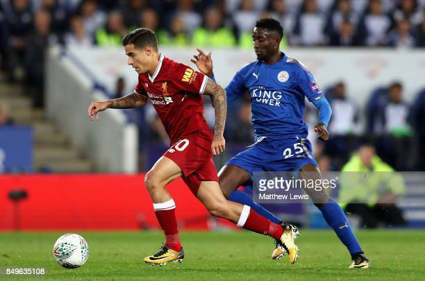 Philippe Coutinho of Liverpool takes the ball past Wilfred Ndidi of Leicester City during the Carabao Cup Third Round match between Leicester City...