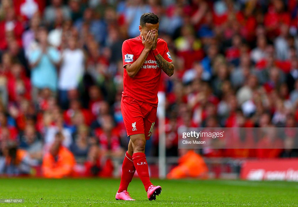Philippe Coutinho of Liverpool walks off the pitch after receiving a red card during the Barclays Premier League match between Liverpool and West Ham United at Anfield on August 29, 2015 in Liverpool, England.