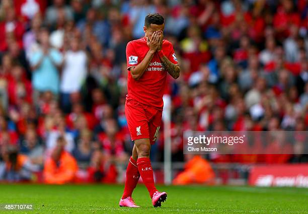Philippe Coutinho of Liverpool walks off the pitch after receiving a red card during the Barclays Premier League match between Liverpool and West Ham...