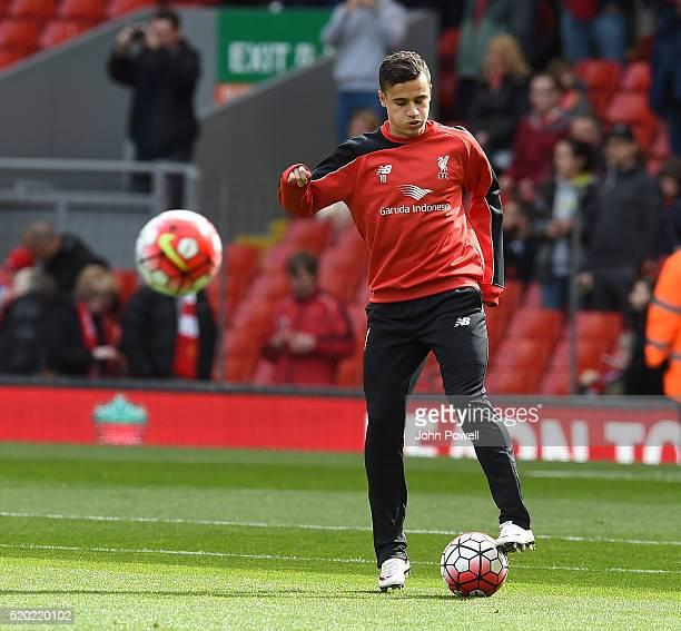 Philippe Coutinho of Liverpool warms up before the Barclays Premier League match between Liverpool and Stoke City at Anfield on April 10 2016 in...