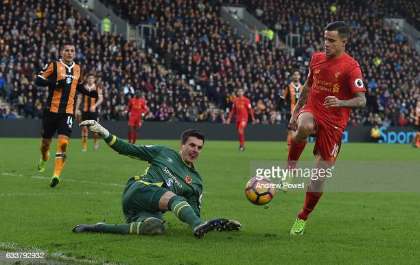 Philippe Coutinho of Liverpool with Eldin Jakupovic of Hull City during the Premier League match between Hull City and Liverpool at KCOM Stadium on...