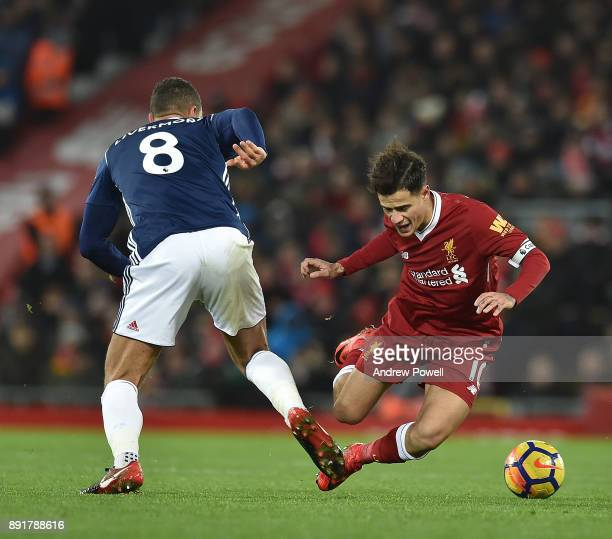 Philippe Coutinho of Liverpool with Jake Livermore of west Brom during the Premier League match between Liverpool and West Bromwich Albion at Anfield...