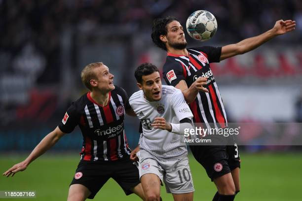 Philippe Coutinho of Muenchen is challenged by Sebastian Rode and Goncalo Paciencia of Frankfurt during the Bundesliga match between Eintracht...