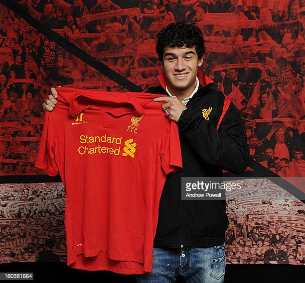Philippe Coutinho poses with the club shirt after signing for Liverpool FC on January 30 2013 in Liverpool England