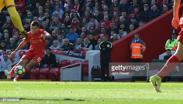 Philippe Coutinho scores the opener for Liverpool during the Premier League match between Liverpool and Crystal Palace at Anfield on April 23 2017 in...