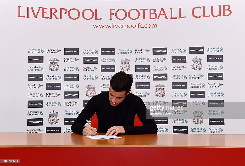 Philippe Coutinho signs a new contract to stay at Liverpool, at Melwood Training Ground on February 3, 2015 in Liverpool, England.