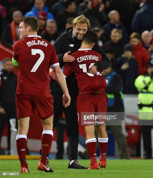 Philippe Coutinho with Jurgen Klopp manager of Liverpool with the match ball after scoring a hatrick during the UEFA Champions League group E match...