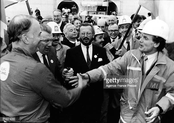 Philippe Cozette Roger Graham and others pose during a ceremony for the Channel Tunnel a high speed rail link connecting England and France on the...