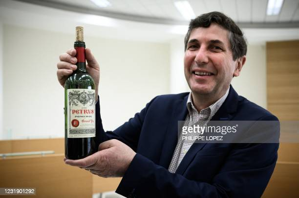 Philippe Darriet, Director of the Oenology Research Unit Institute of Vines, Science and Wine holds a bottle of Petrus, at the University of Bordeaux...