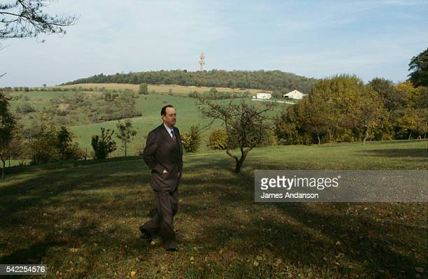 Philippe de Gaulle the eldest son of General de Gaulle walks in the park at his ancestral home La Boisserie In the distance stands the Lorraine Cross...