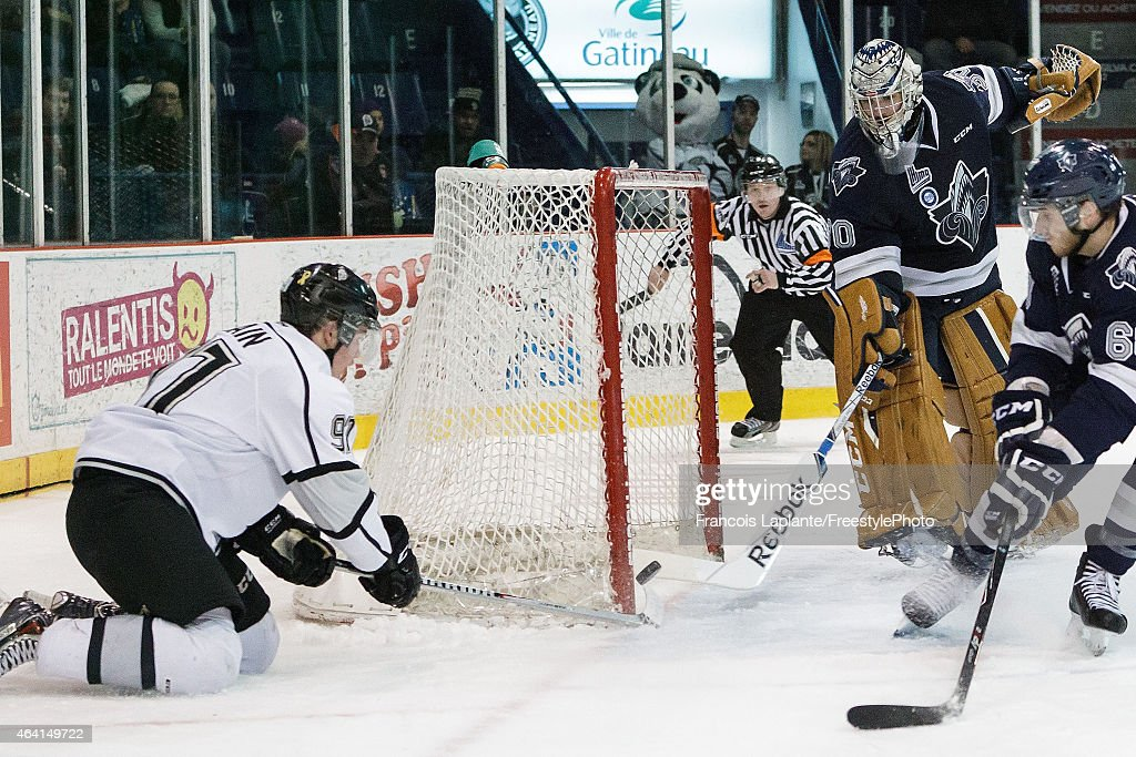 Philippe Desrosiers #30 of the Rimouski Oceanic pokes the puck with the tip of his stick as Alexandre Alain #91 of the Gatineau Olympiques misses a wrap-around wide open net on February 22, 2015 at Robert Guertin Arena in Gatineau, Quebec, Canada.