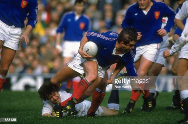 Philippe Dintrans of France is tackled by Simon Halliday of England during the International Championship match at Twickenham in London England won...