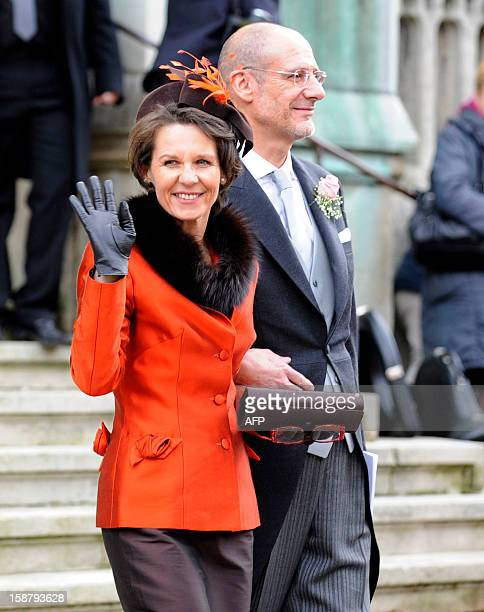 Philippe DrapéFrisch and his wife wave as they leave the Saint Epvre Basilica after the wedding of their daughter Archduchess Adelaide DrapeFrisch...