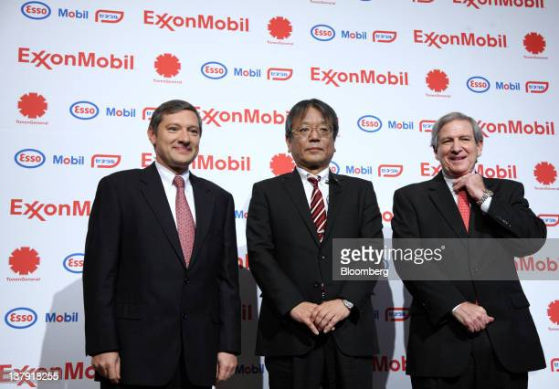 Philippe Ducom president of ExxonMobil Group Japan left Jun Muto managing director of TonenGeneral Sekiyu KK center and Sherman Glass vice president...