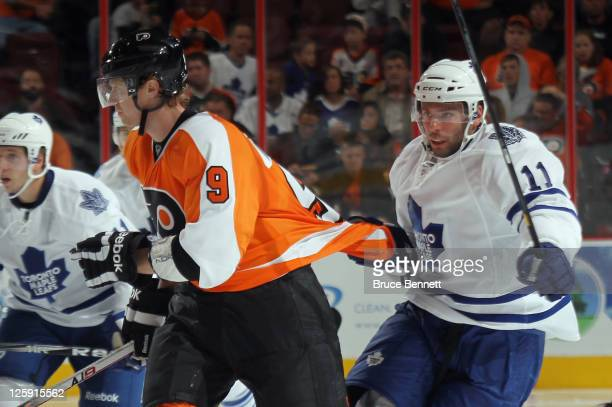 Philippe Dupuis of the Toronto Maple Leafs hangs on to Jakub Voracek of the Philadelphia Flyers at the Wells Fargo Center on September 21 2011 in...