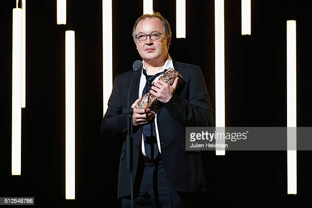 Philippe Faucon poses with his award for best film for 'Fatima' on stage during The Cesar Film Award 2016 at Theatre du Chatelet on February 26 2016...