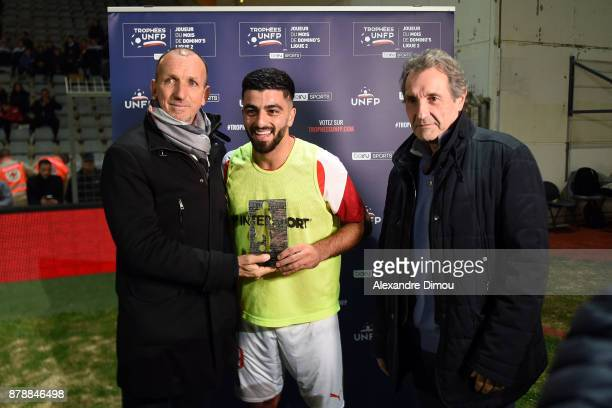 Philippe Fluckinger of UNFP and Umut Bozok of Nimes receives the trophy of Best Player of October and Jean Jacques Bourdin Journalist during the...