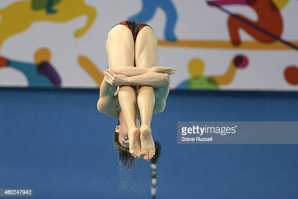 TORONTO ON JULY 10 Philippe Gagne of Canada performs a back 2 1/2 Somersault in the pike position in the mens 3 metre springboard diving...