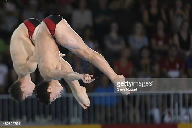 TORONTO ON JULY 13 Philippe Gagne right and Vincent Riendeau of Canada leap into the pike position The pair would win the silver in the men's 10...