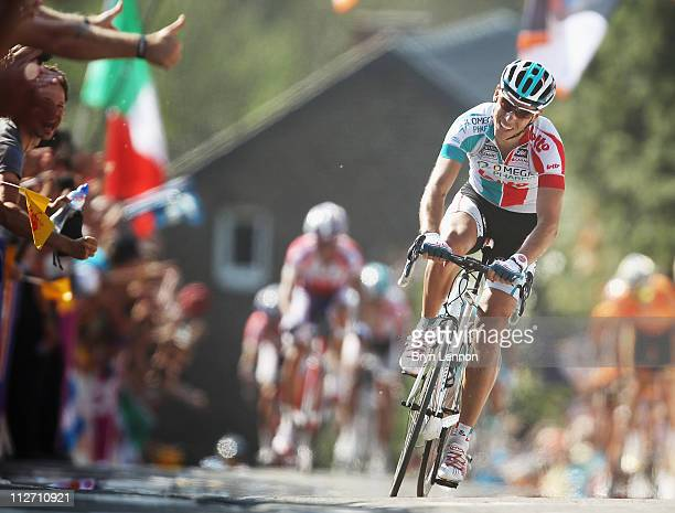 Philippe Gilbert of Belgium and Omega PharmaLotto approaches the finish line on his way to winning the 75th La Fleche Wallonne 2011 Cycle Race from...
