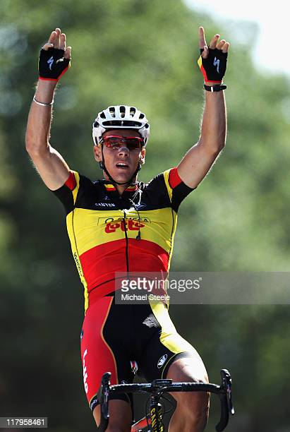 Philippe Gilbert of Belgium and Omega PharmaLotto celebrates winning stage one of the 2011 Tour de France from the Passage du Gois to Mont des...