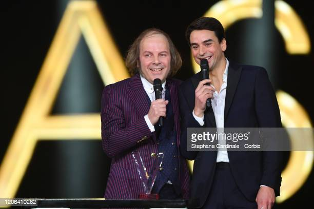 Philippe Katerine celebrates after receiving the best male artist award next to Julian Bugier during the 35th 'Les Victoires De La Musique' Show At...