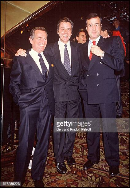 Philippe Labro Alain Delon and Charles Villeneuve at the party organized by the 'Elle' magazine