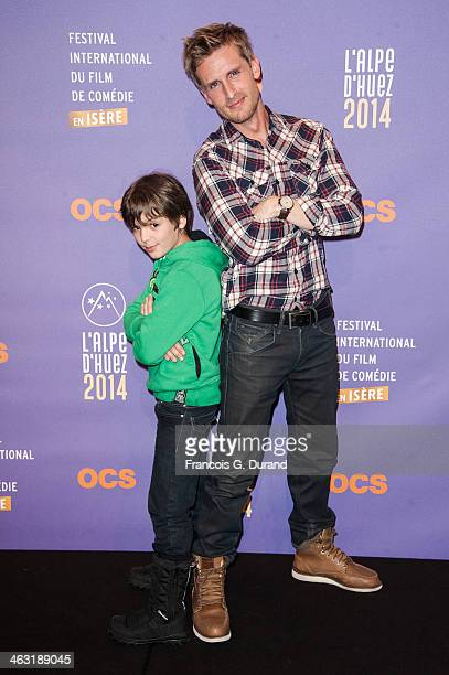 Philippe Lacheau and Enzo Tomasini pose during the 'Baby Sitting' Photocall as part of the 17th L'Alpe D'Huez International Comedy Film Festival on...