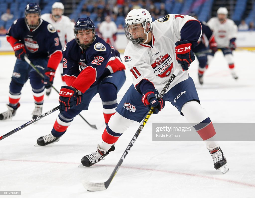 Philippe Lapointe #11 of Team Chelios with the puck as Jake Pivonka #22 of Team Leetch defends in the first period during the CCM/USA Hockey All-American Prospects Game at the KeyBank Center on September 21, 2017 in Buffalo, New York.